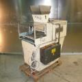 Машина типа Portiomat 7/480 для производства ореховых кластеров  с рабочей шириной 480 мм.